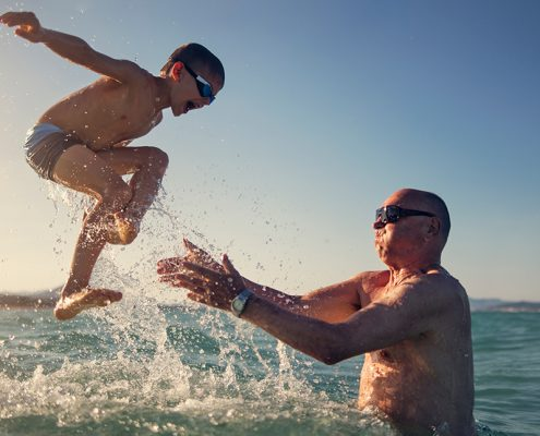 child and son jumping